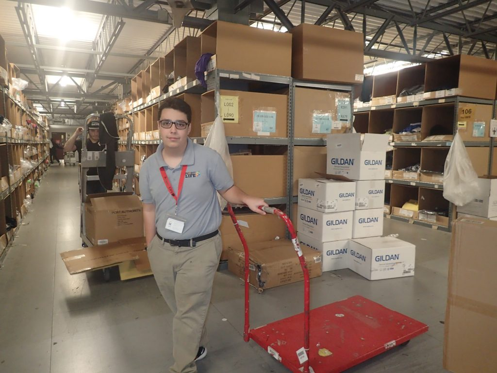 student working in warehouse